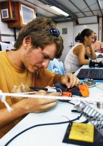 CCS Intern at RSMAS uses soldering tool