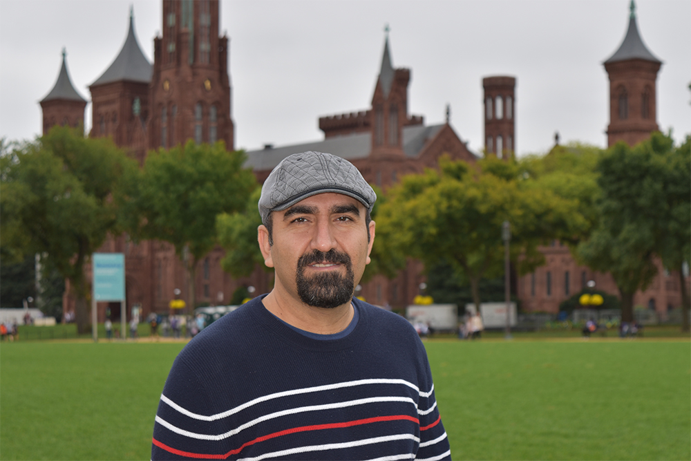Amin Sarafraz in front of the Smithsonian